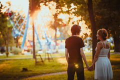Guy and the girl hugging at amusement background Royalty Free Stock Photography