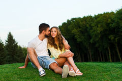 Guy and girl hugging in the park. Evening date. Royalty Free Stock Photos