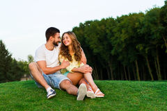 Guy and girl hugging and smile in the park. Stock Image