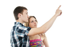 Guy with a girl indicates upwards Stock Photos