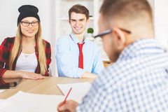 Guy and girl interviewed for a job Stock Images