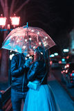 Guy and girl kissing under an umbrella Royalty Free Stock Photo