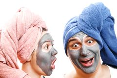 A guy with a girl looks in surprise, mask for skin man and woman, guy with a girl make a mask for the skin together, funny couple royalty free stock photos