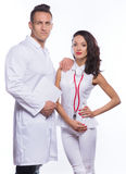 Guy and girl in medical garb with documents Stock Photo