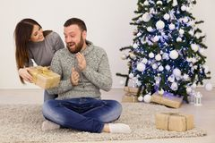 A guy with a girl open Gifts Christmas new year Stock Images