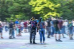Guy and girl in paint at the Festival of colours Stock Image