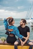 Guy and girl on pier Stock Image