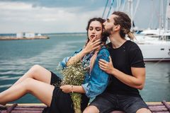 Guy and girl on pier Stock Photography