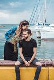 Guy and girl on pier. Posing on camera Royalty Free Stock Images