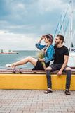Guy and girl on pier. Posing on camera Royalty Free Stock Photography