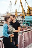 Guy and girl on pier. Posing on camera Stock Images