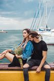 Guy and girl on pier. Posing on camera Stock Photos
