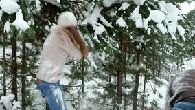 A guy with a girl playing snowballs stock video footage