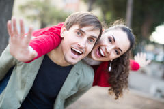 Guy and girl posing outdoors Royalty Free Stock Image