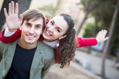 Guy and girl posing outdoors Royalty Free Stock Images