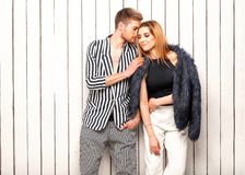 Guy with a girl posing in the studio near the window, Vogue sty. Le Royalty Free Stock Photo