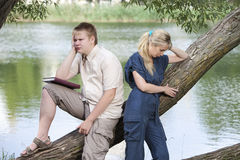 The guy and the girl in quarrel on the bank of the lake Royalty Free Stock Photography