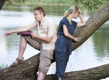 The guy and the girl in quarrel on the bank of the lake Stock Photography