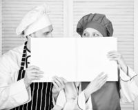 Guy and girl read book recipes. Culinary concept. Family learn recipe. Improve cooking skill. Book family recipes royalty free stock image
