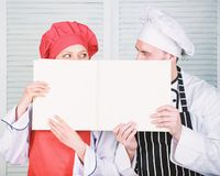 Guy and girl read book recipes. Culinary concept. Family learn recipe. Improve cooking skill. Book family recipes royalty free stock images