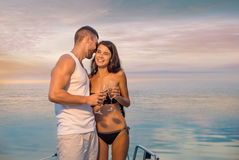 Guy with  girl relaxing on the yacht. Royalty Free Stock Photos