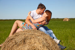 Guy and girl resting on the meadow. Royalty Free Stock Photo