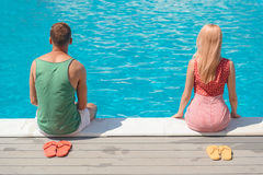 Guy and girl resting near water stock photography