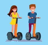 Guy and girl ride electric scooter Royalty Free Stock Image