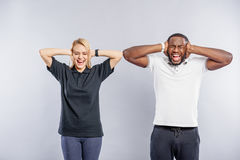 Guy and girl shouting with irritation Royalty Free Stock Photos