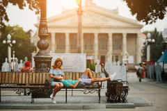 Guy and girl sitting on a bench Royalty Free Stock Photos