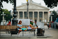 Guy and girl sitting on a bench Stock Image