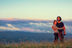 The guy and the girl are sitting high in the mountains. Love, friendship, intimacy, the opportunity to be together. Trekking in th Royalty Free Stock Photo