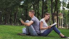 A Guy And A Girl Are Studying In The Park stock video