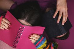 A guy and a girl trying to learn. The concept of the study, fatigue.  Stock Photo