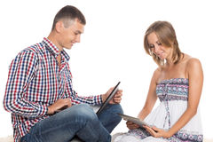 Guy and girl using a laptop and tablet PC Royalty Free Stock Photography