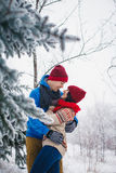 Guy and girl walk and have fun in the forest. In winter Stock Images