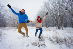 Guy and girl walk and have fun in the forest. In winter Stock Image