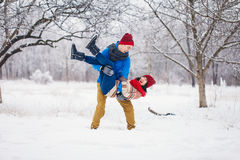 Guy and girl walk and have fun in the forest. In winter Royalty Free Stock Images