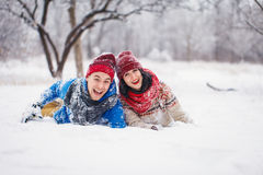 Guy and girl walk and have fun in the forest. In winter Stock Photography