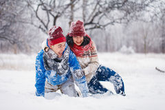Guy and girl walk and have fun in the forest. In winter Royalty Free Stock Image