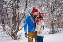 Guy and girl walk and have fun in the forest. In winter Stock Photo