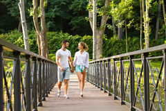 Guy and a girl walk in the park. Royalty Free Stock Photos