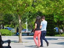 Guy and the girl walk in park Royalty Free Stock Photo