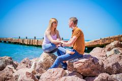 The couple on the bench. The guy with the girl walking along the sea promenade and the Park enjoying nature Stock Photos