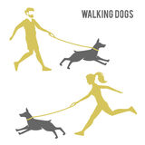 The guy and the girl walking a dog. A man and a woman walking a dog. logo design for dog walking, training or dog related business. Dog obedience stock illustration