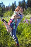 A guy and a girl are walking in the field of lupines Stock Photography