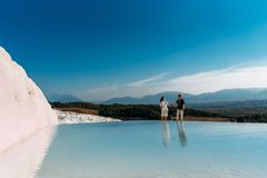 A couple in love walks along the shore of a mountain lake stock image