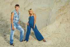 Guy and  girl in  white sand Stock Images