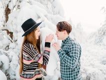 Guy and girl in winterwear enjoying snowfall. Happy moment, Christmas time. Guy and girl in winterwear enjoying snowfall. Happy moment Stock Photo