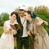 Guy and girls hipsters are engaged in self-development by book a Royalty Free Stock Photos